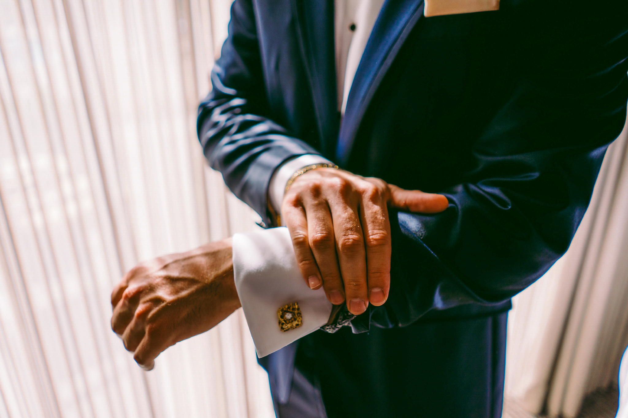 san diego wedding   photographer | man revealing sleeve cuffs by the window