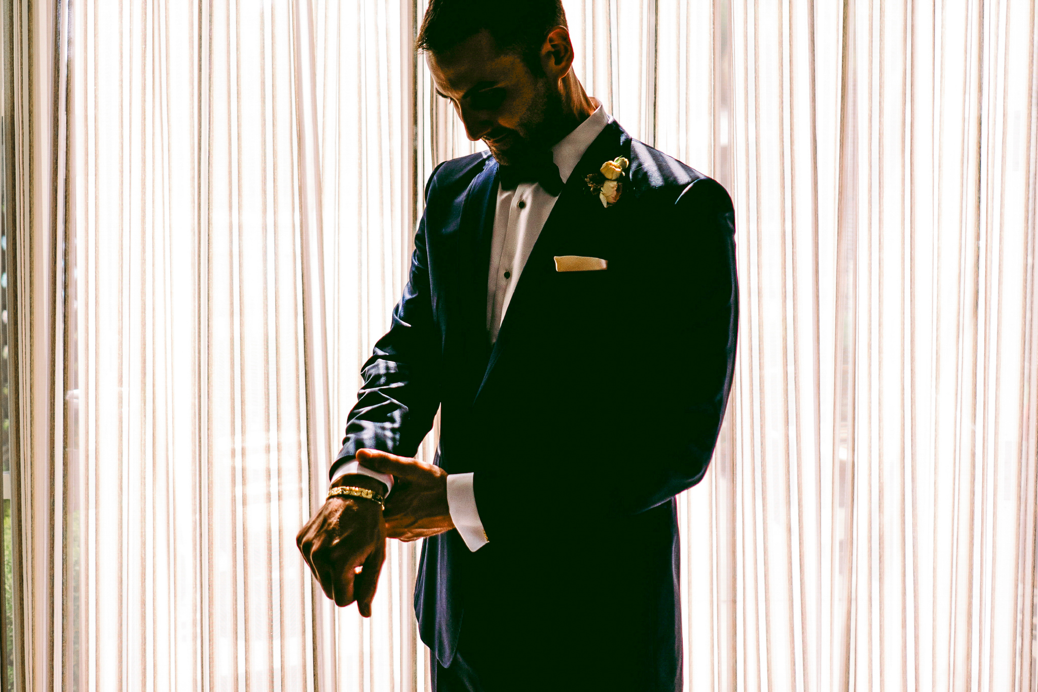 san diego wedding   photographer | man looking down fixing the sleeve of his suit
