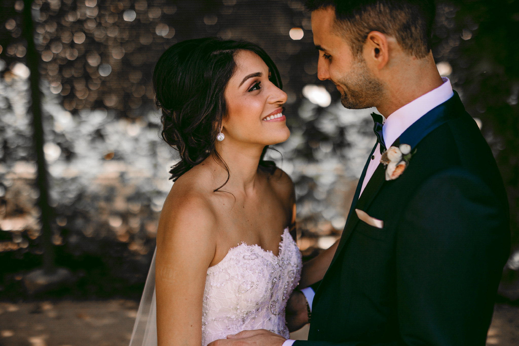 san diego wedding   photographer | woman in wedding dress looking up to man in suit