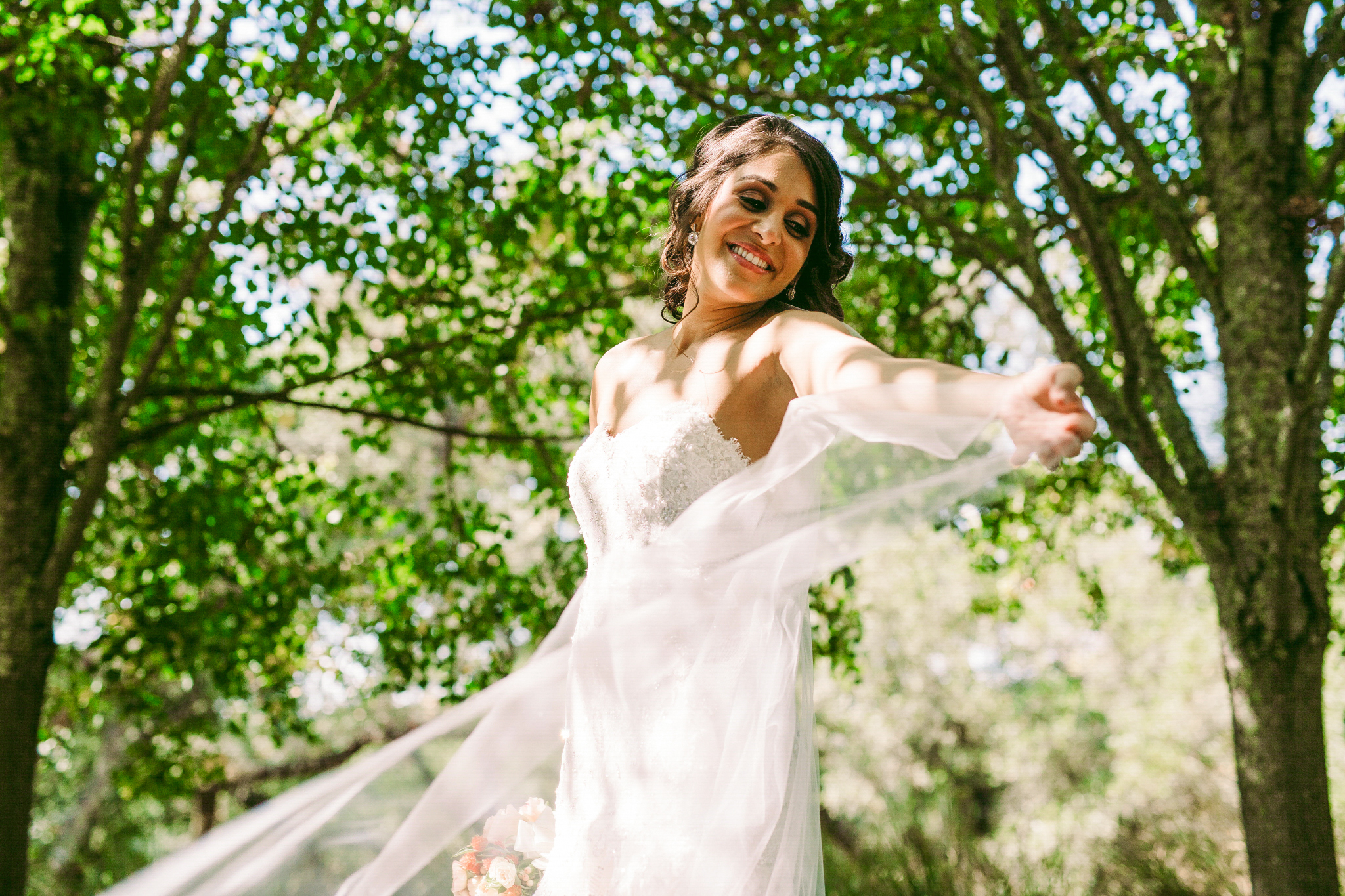 san diego wedding   photographer | woman in wedding dress with arms wide open