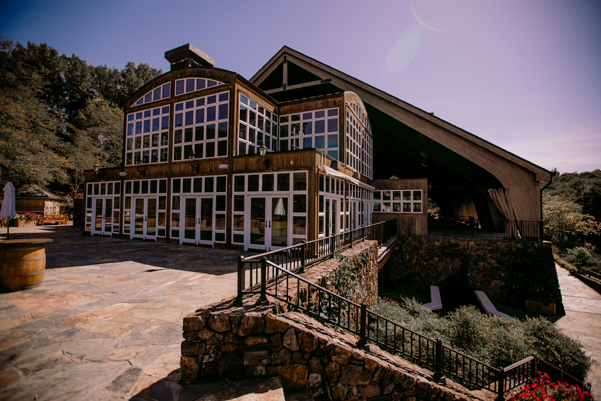 san diego wedding   photographer | structure with many glass windows and large covered building   behind