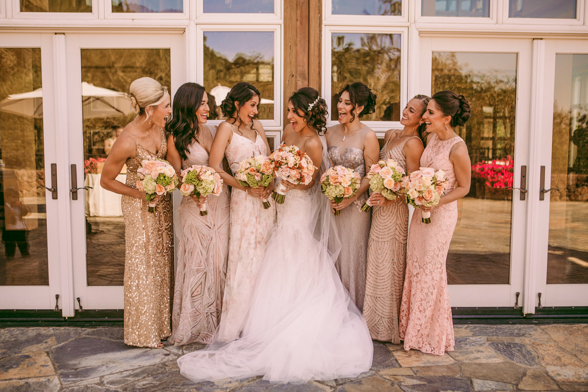 san diego wedding   photographer | women in dresses holding bouquets of flowers while laughing   with each other