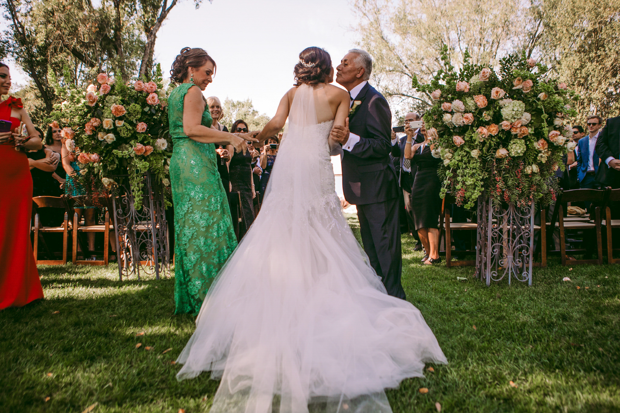 san diego wedding   photographer | woman in wedding dress about to kiss old man on cheek