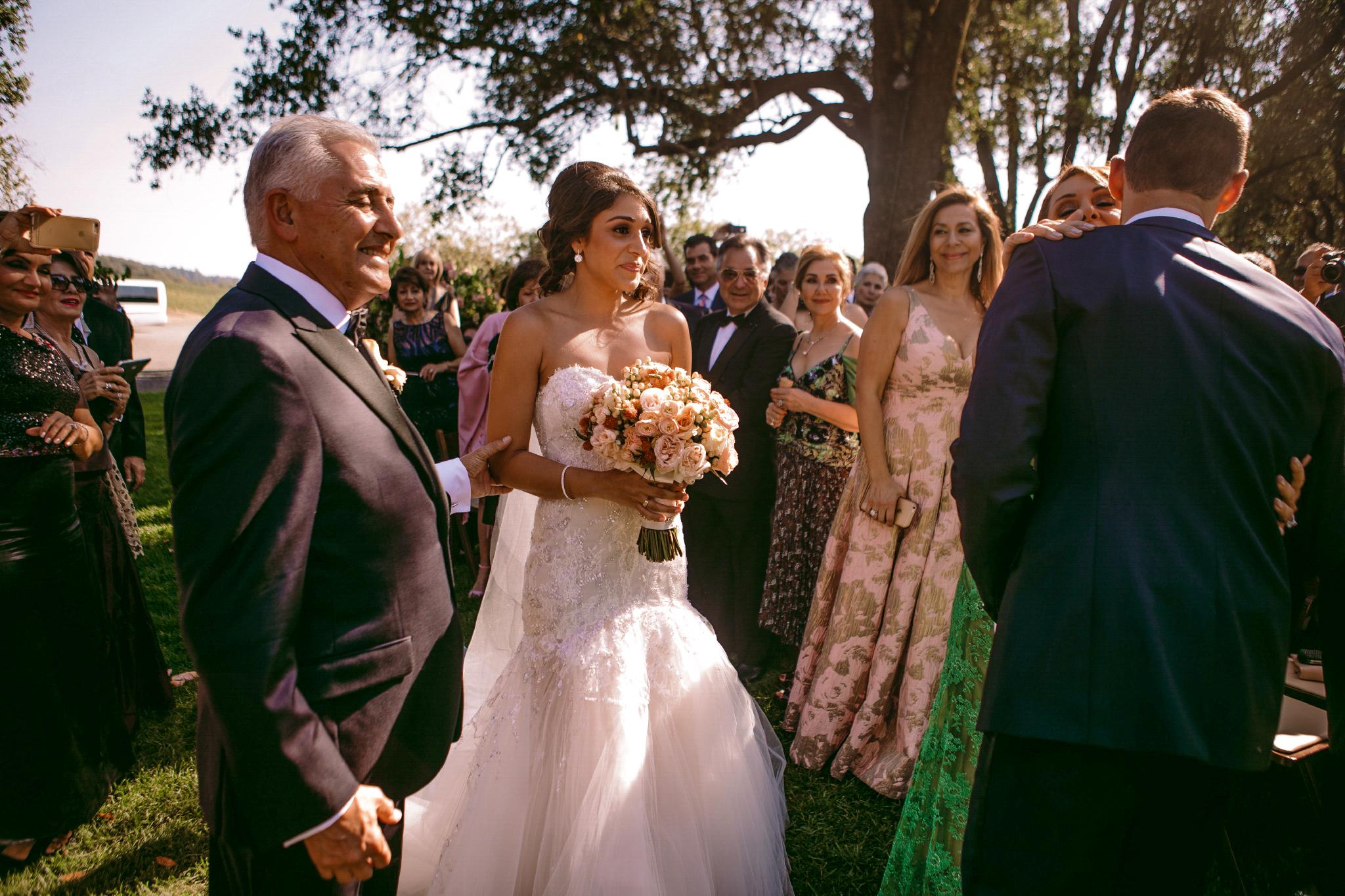 san diego wedding   photographer | bride staring at groom kissing old woman's cheek