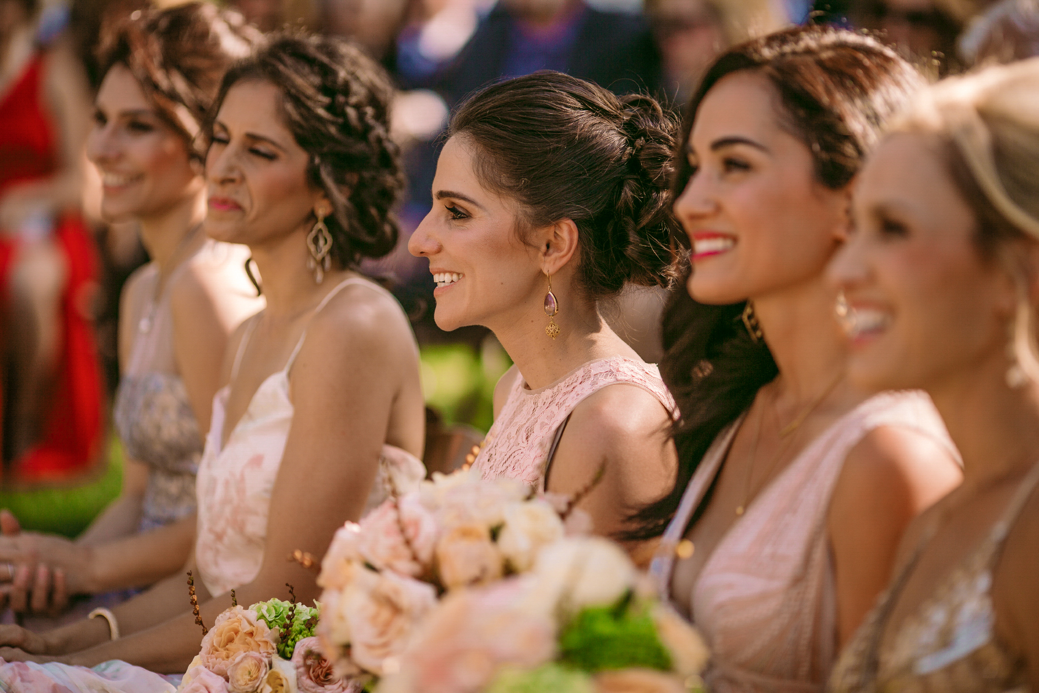 san diego wedding   photographer | group of women in dresses holding bouquets seated next to each   other