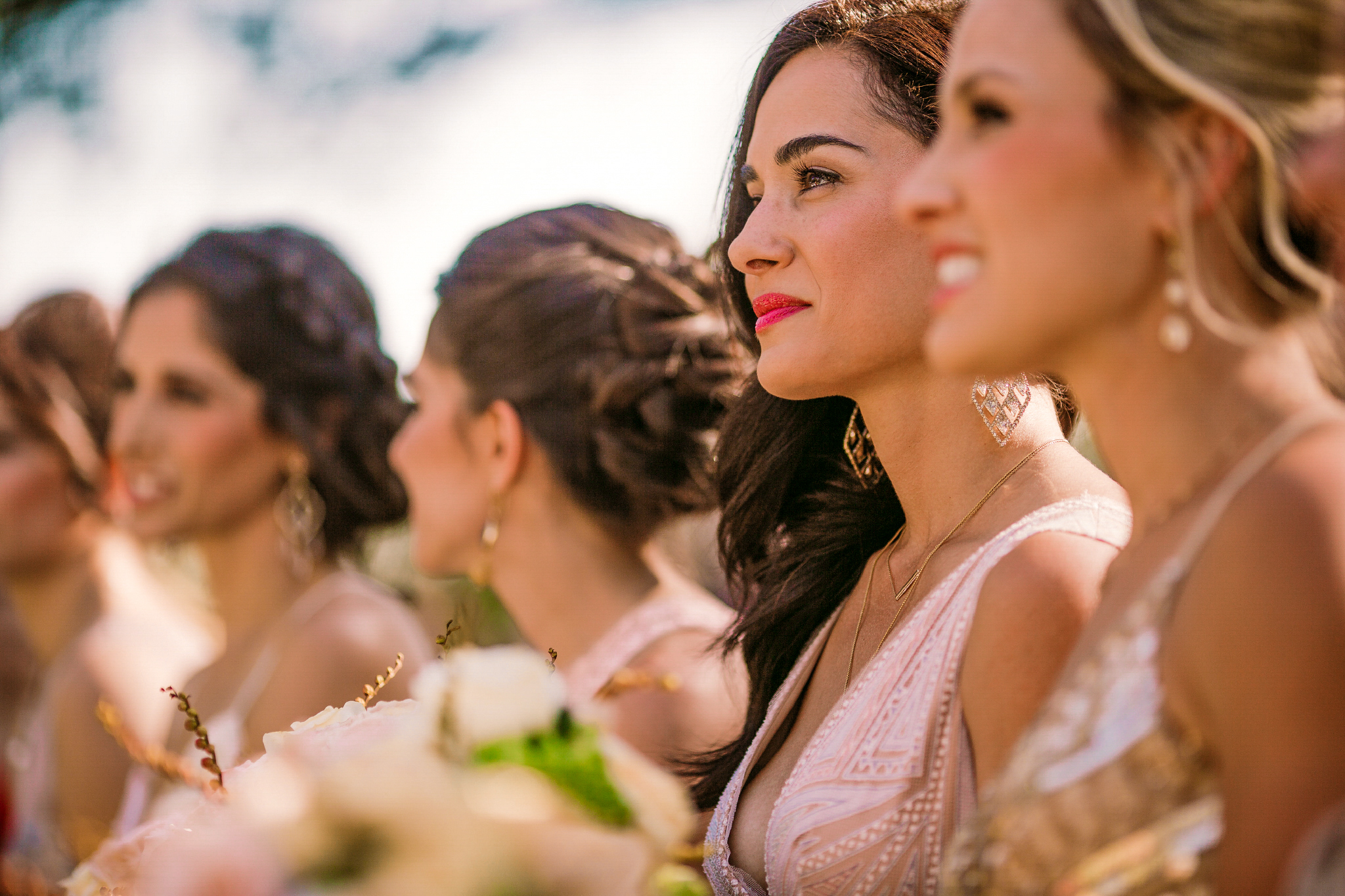 san diego wedding   photographer | woman in crowd of women in dresses in focus as she looks in   front