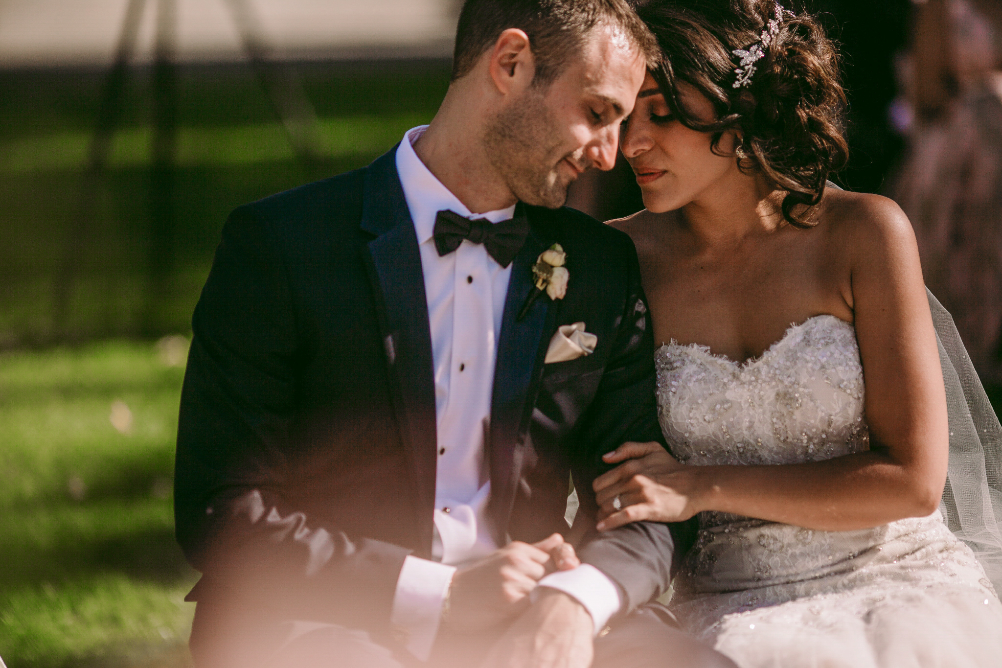 san diego wedding   photographer | married couple sitting down while woman looks to man's side