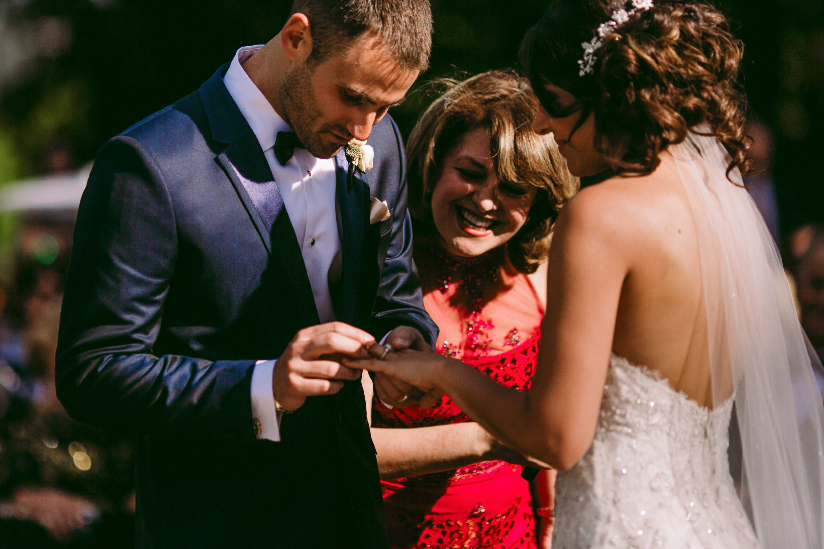 san diego wedding   photographer | man puts wedding ring on woman's finger