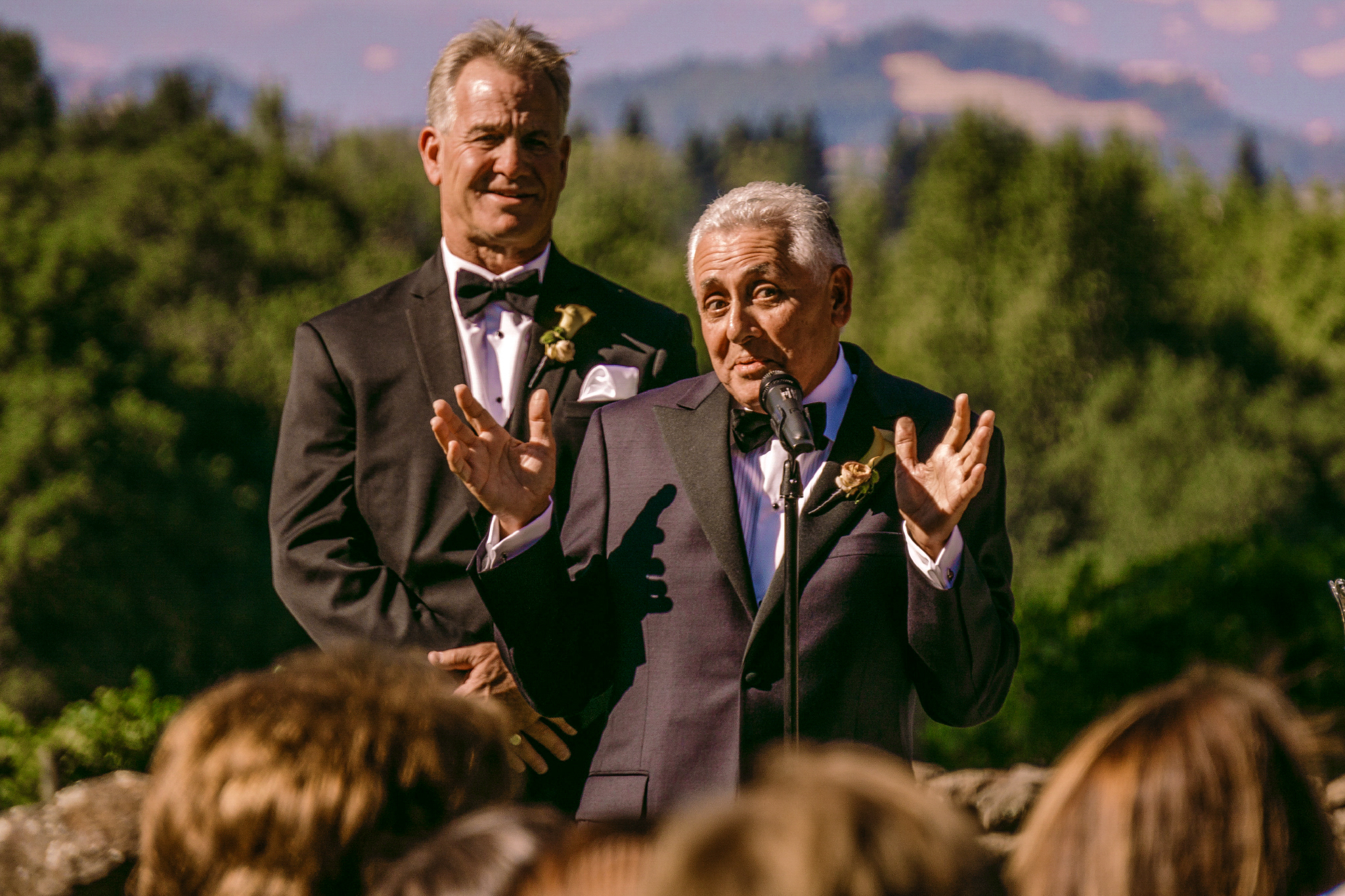 san diego wedding   photographer | man standing with hands up while speaking with mic