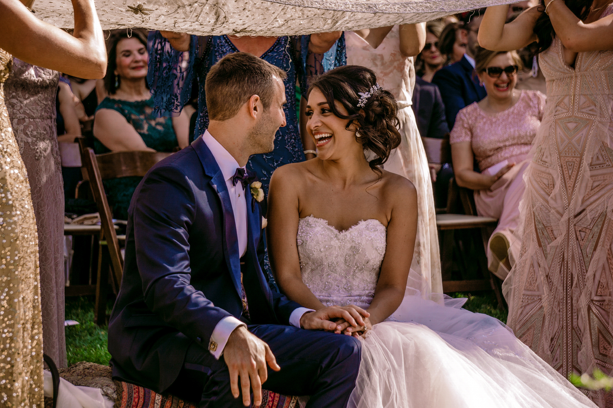 san diego wedding   photographer | married couple sitting while woman laughs looking at man