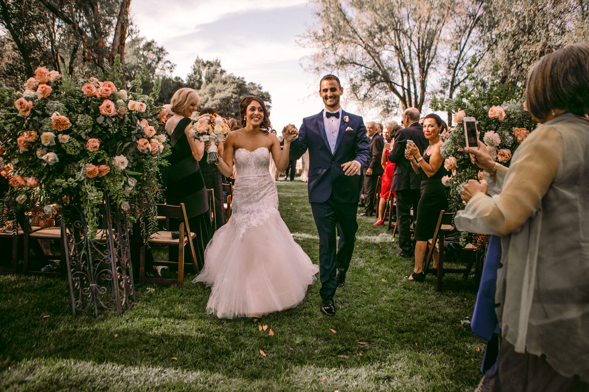 san diego wedding   photographer | married couple holding hands smiling walking down the aisle
