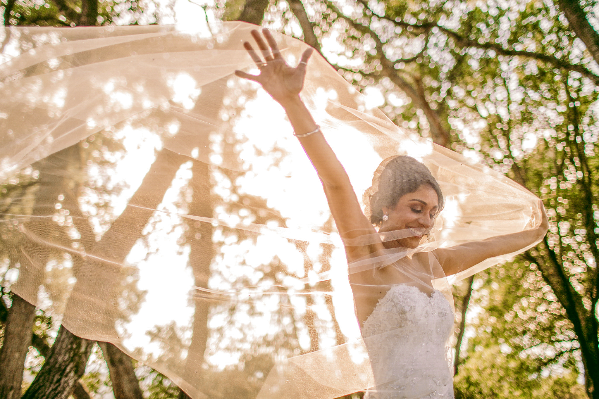 san diego wedding   photographer | bride seen through veil with arms up wide open