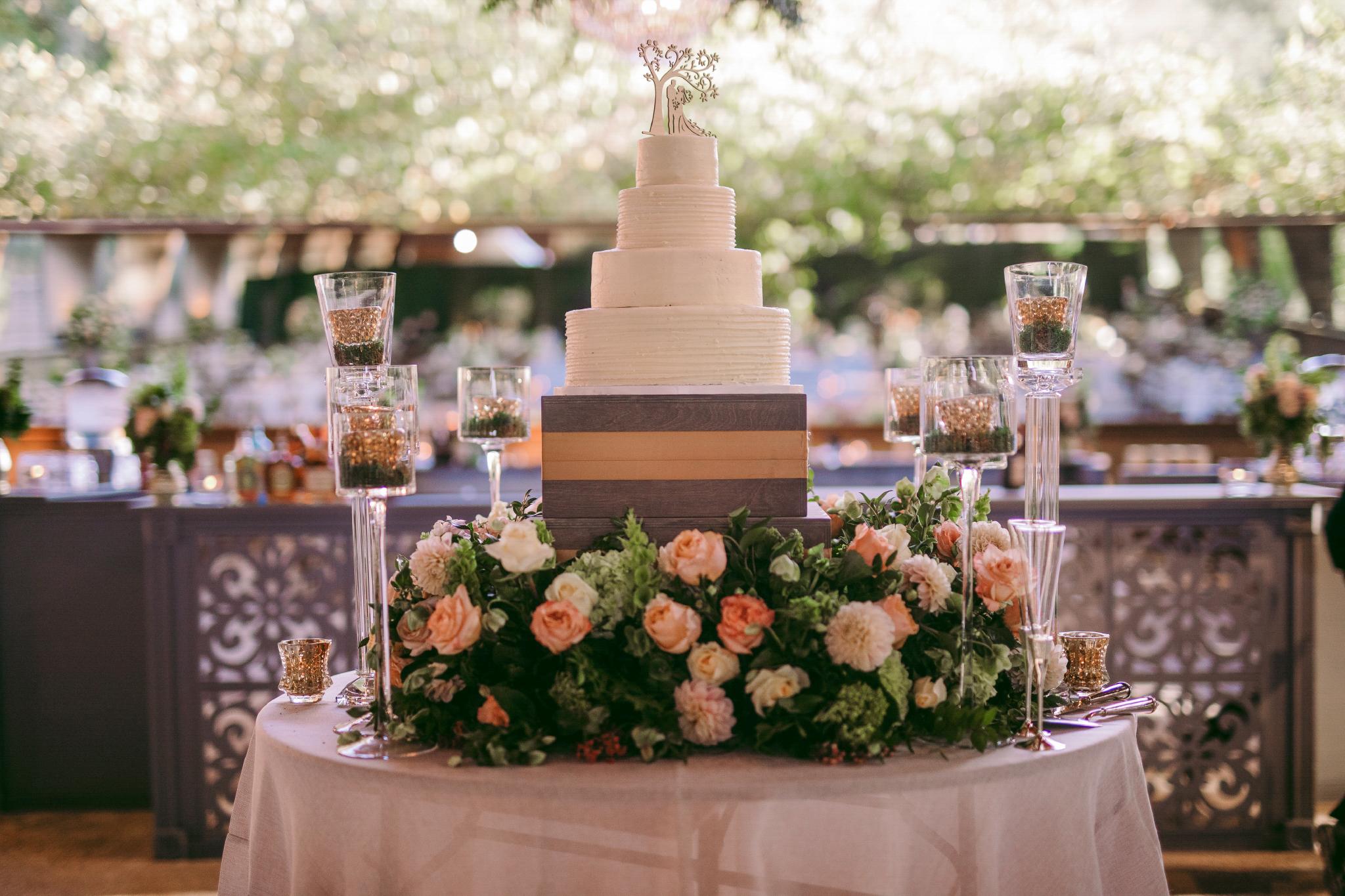 san diego wedding   photographer | white wedding cake surrounded by flowers