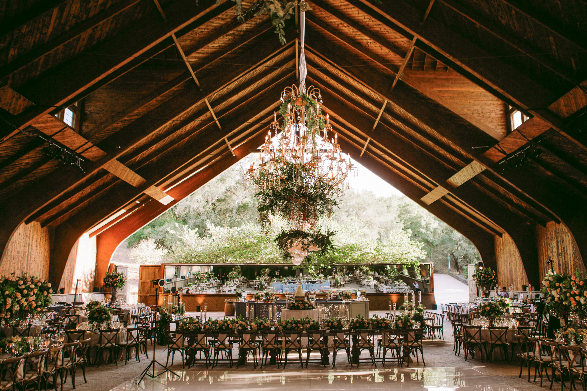 san diego wedding   photographer | dining area filled with flowers and chandelier in the middle   of the room