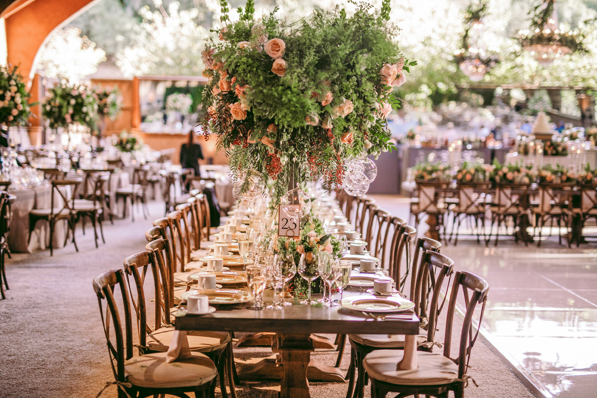 san diego wedding   photographer | table number 23 filled with flower arrangements