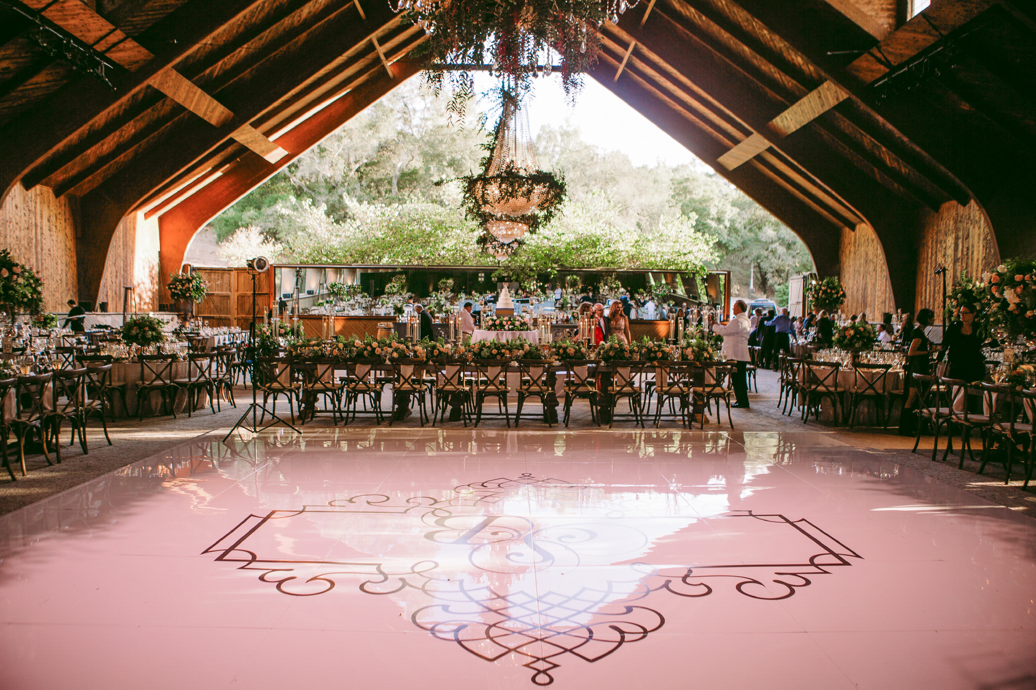 san diego wedding   photographer | dining area with view of dance floor with chandelier in   background
