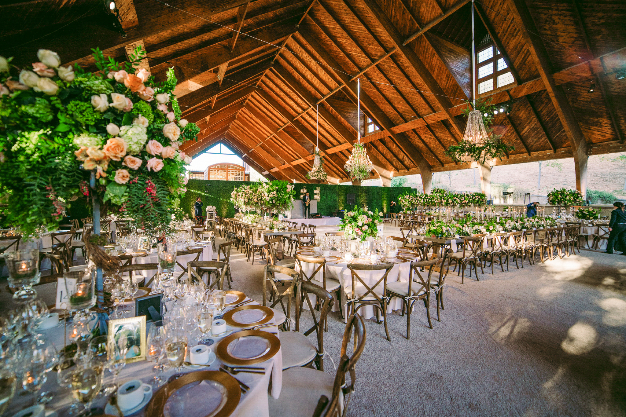 san diego wedding   photographer | view of dining area with several lighting fixtures decorated   with flowers