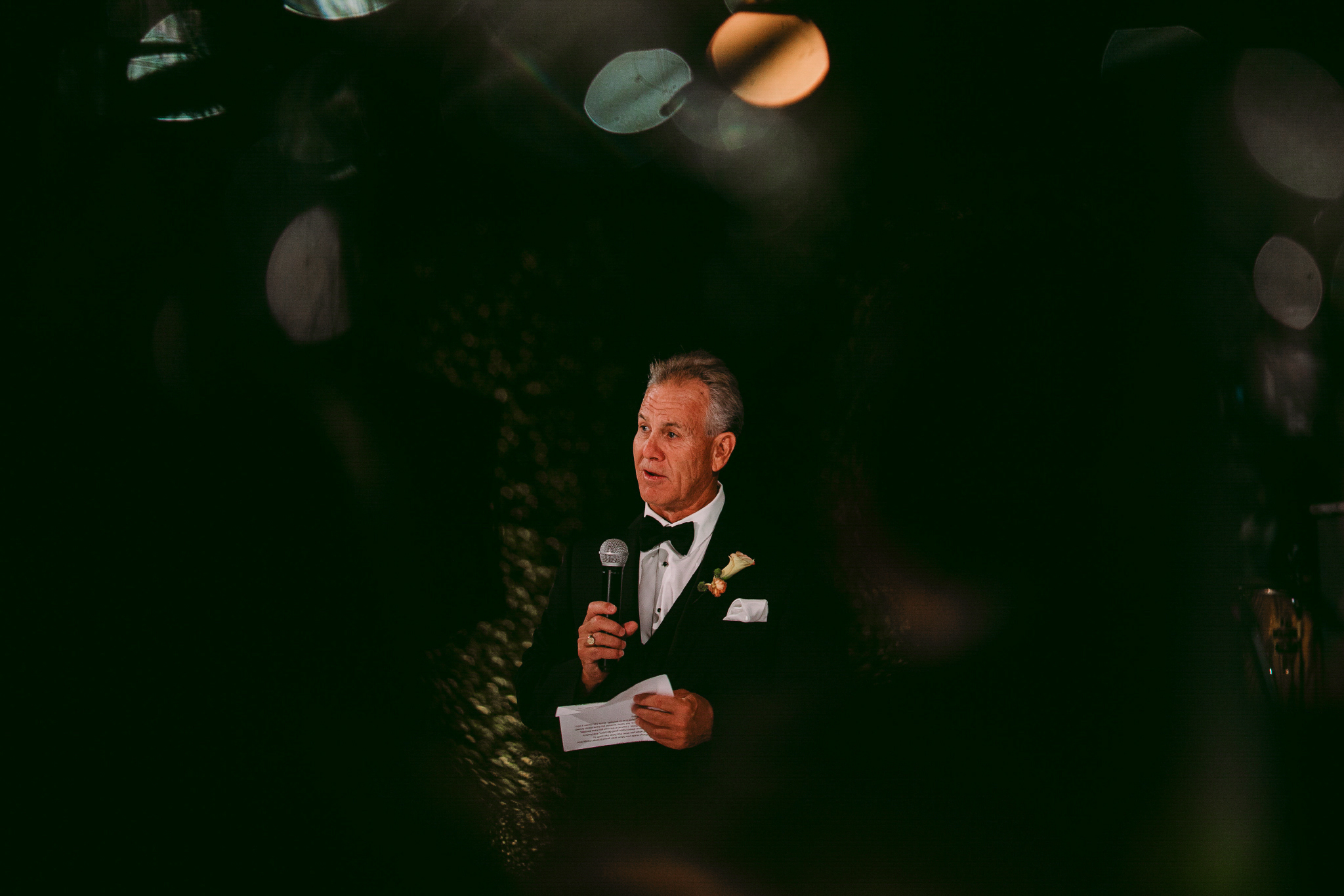 san diego wedding   photographer | man in suit holding mic and paper standing in front
