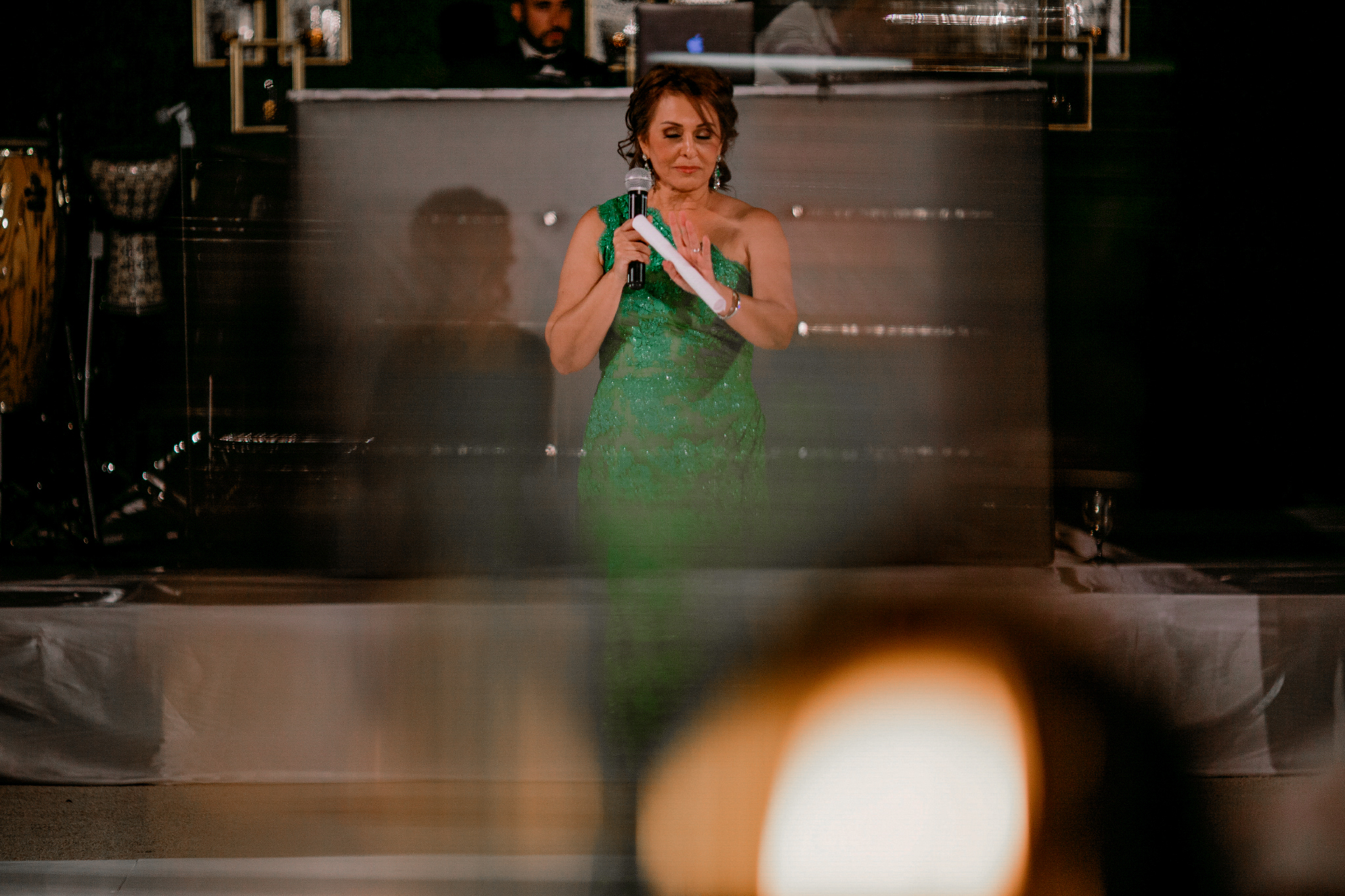 san diego wedding   photographer | woman in green dress standing in front holding mic