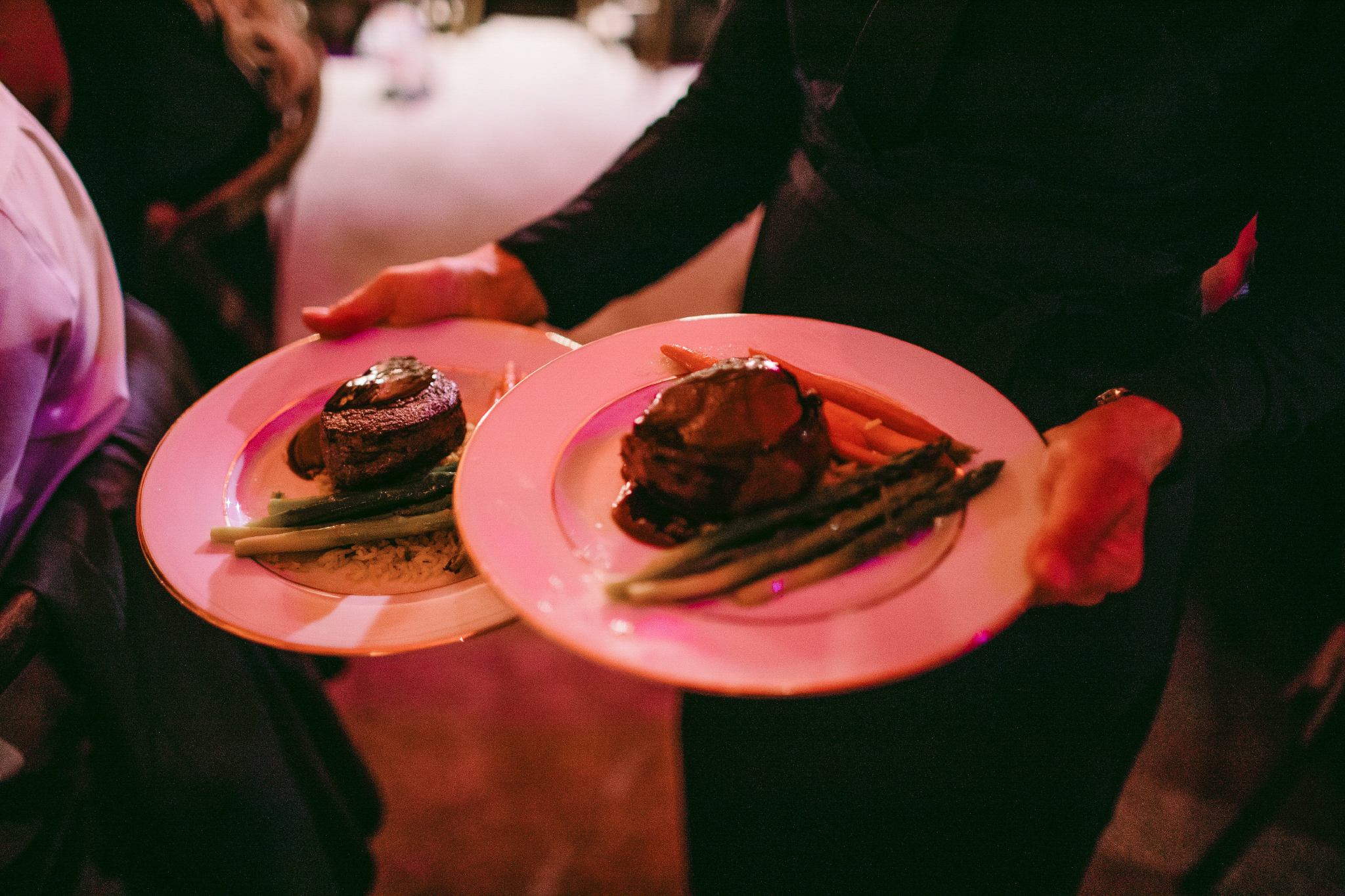 san diego wedding   photographer | 2 plates of food being carried by person in black attire