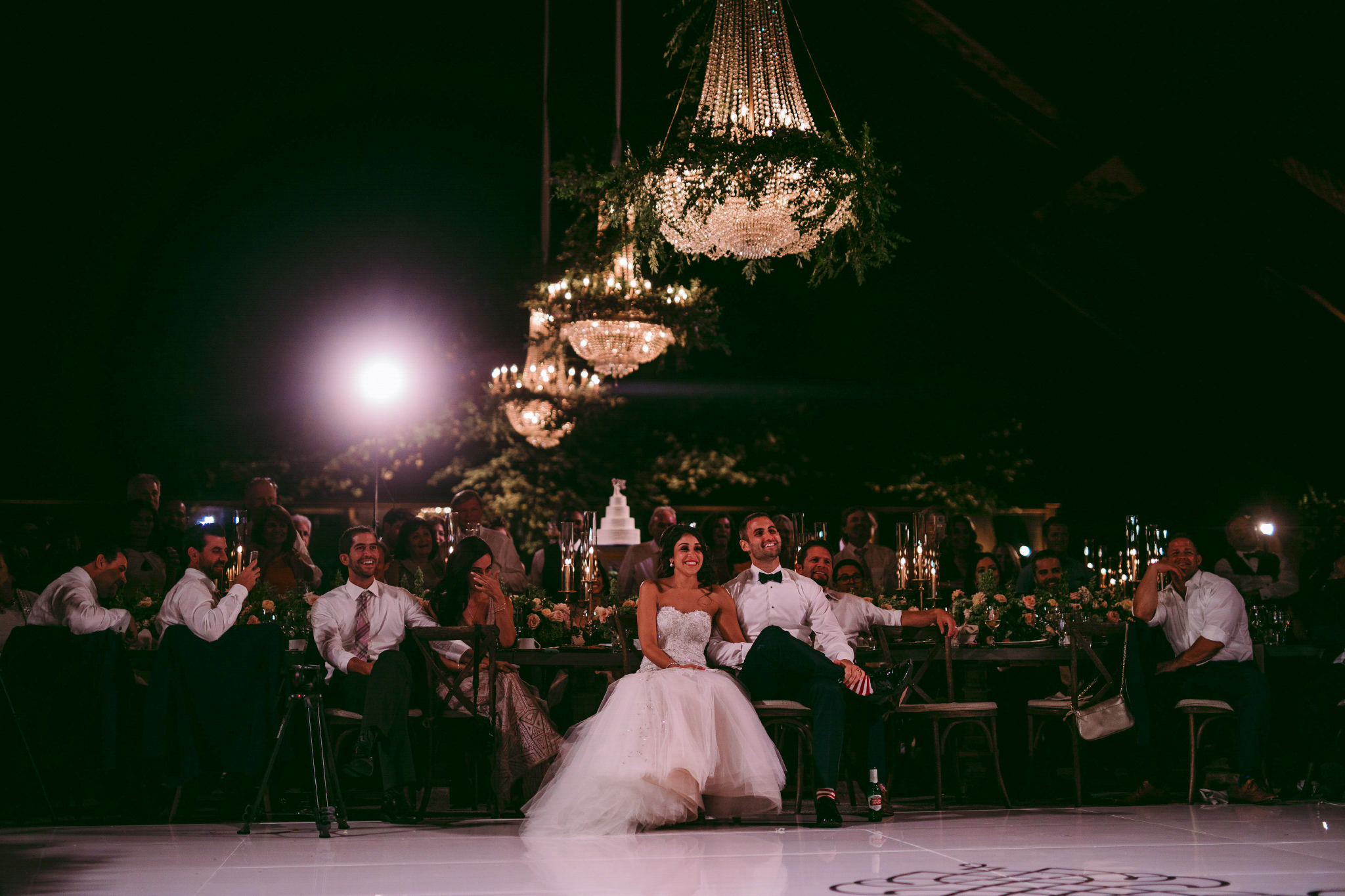 san diego wedding   photographer | shot of dance floor with the married couple seen from behind   under chandelier