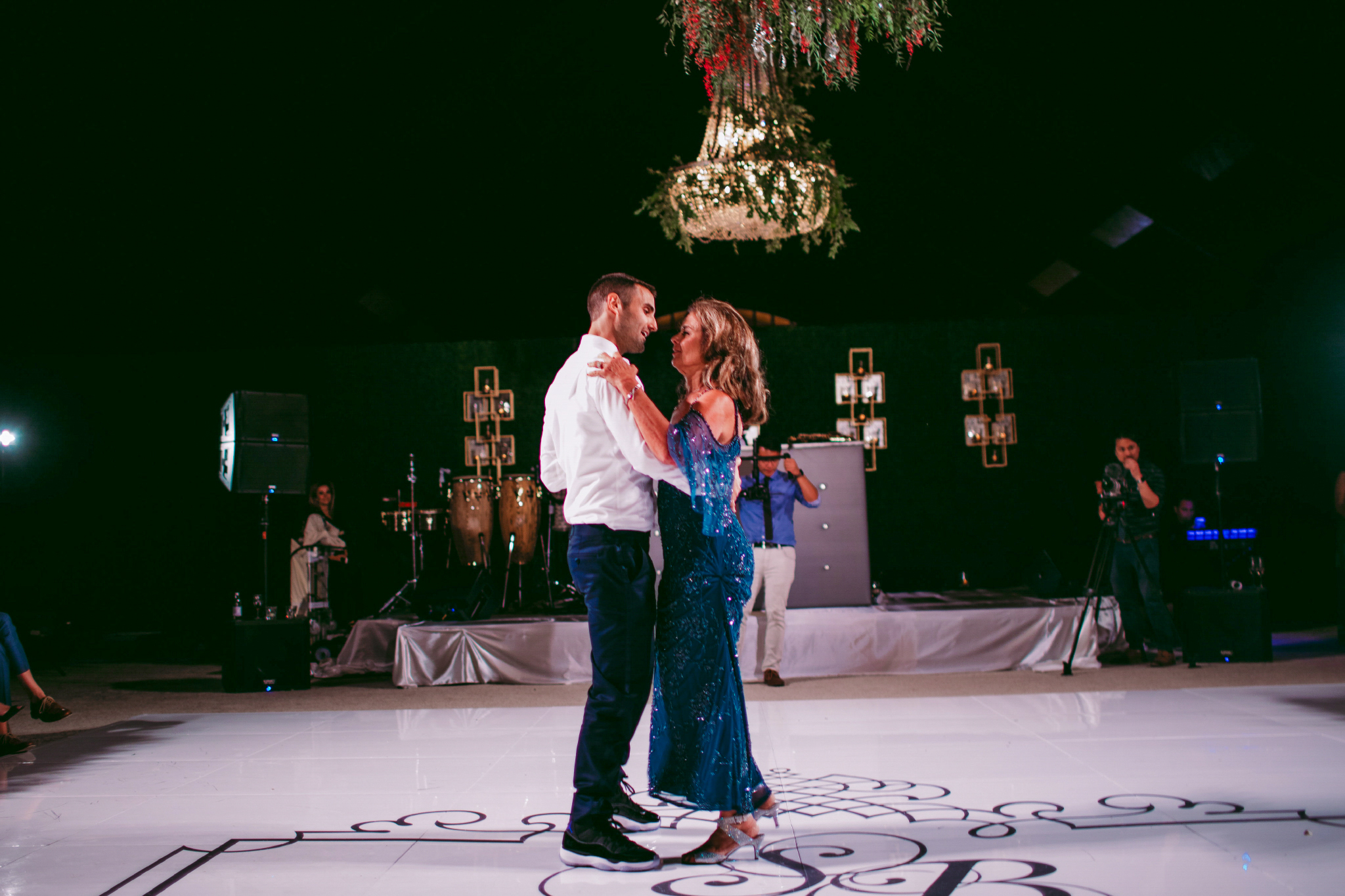 san diego wedding   photographer | groom dances with his mother in blue dress in the middle of   the dance floor