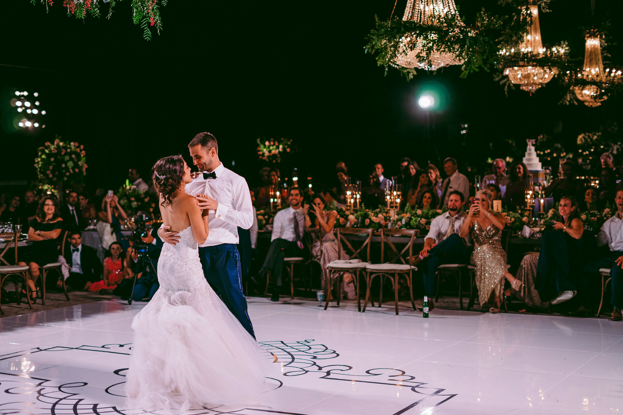 san diego wedding   photographer | married couple dances while looking at each other in the   middle of the dance floor