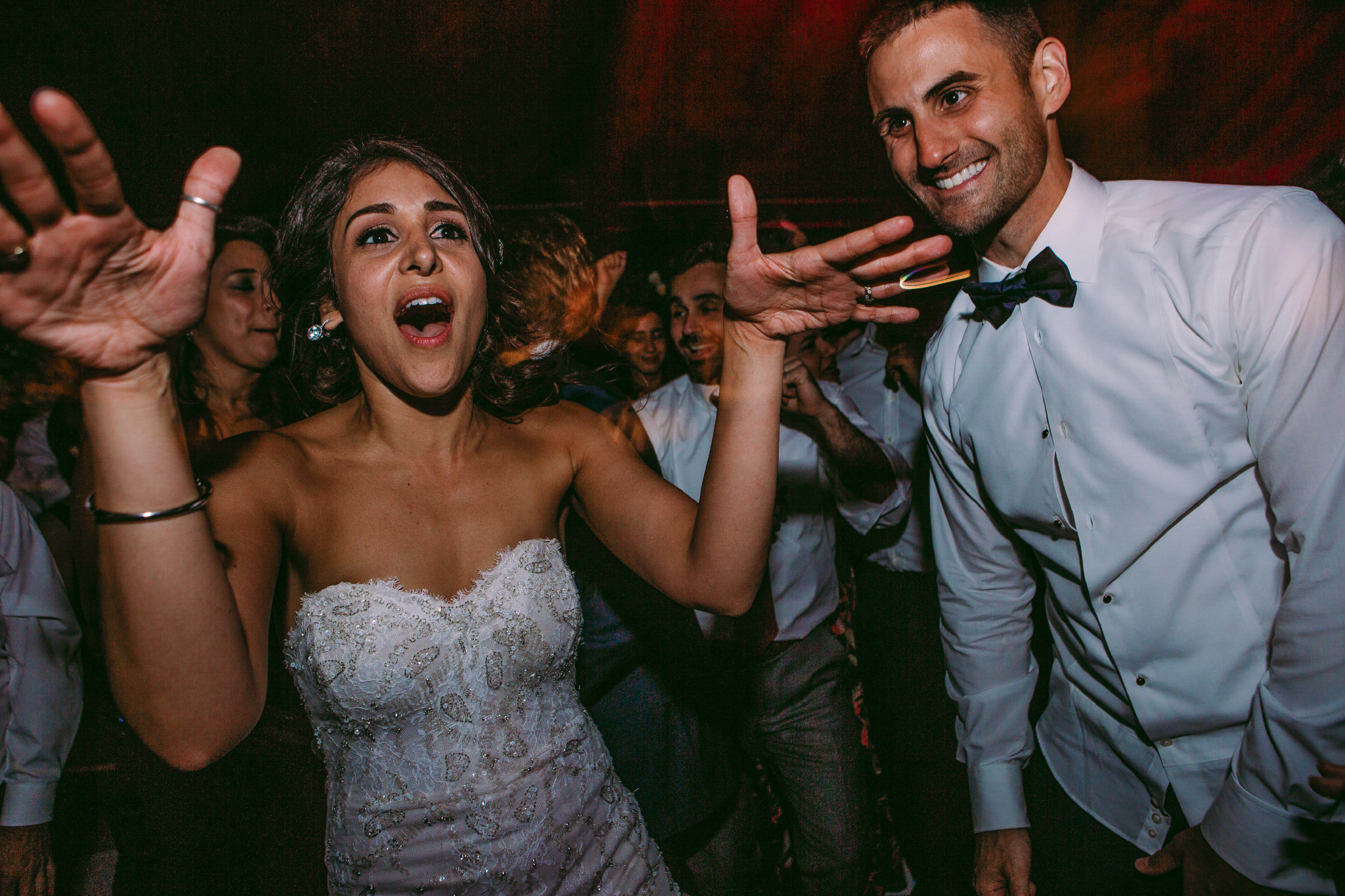 san diego wedding   photographer | bride with her mouth open and arms up standing beside her   groom