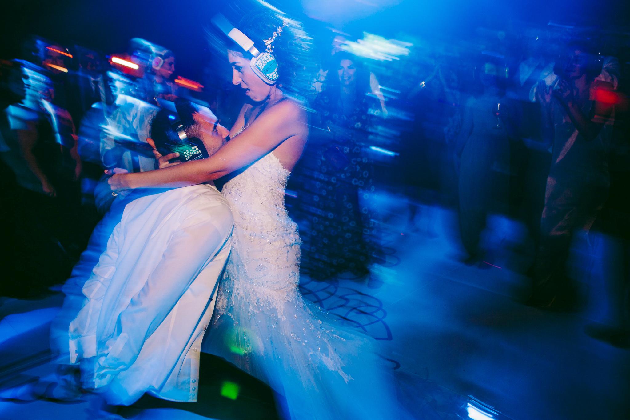 san diego wedding   photographer | married couple wearing noise canceling headphones dancing
