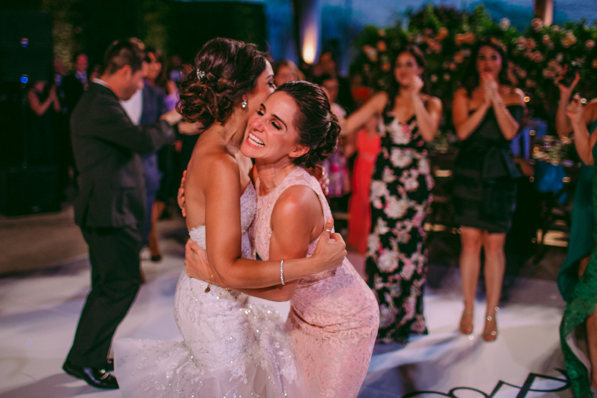 san diego wedding   photographer | bride hugging woman in light pink dress with women in   background