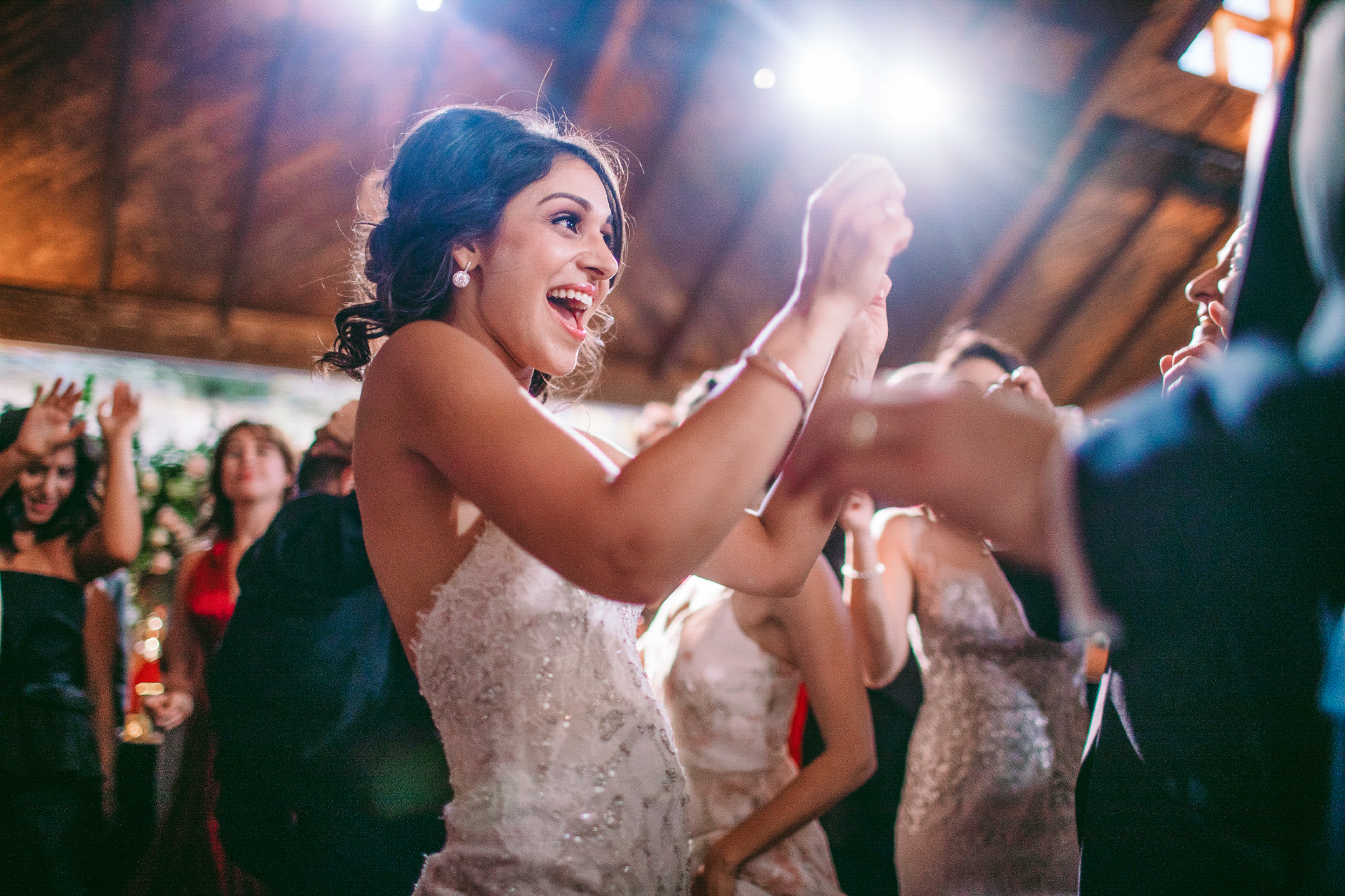 san diego wedding   photographer | bride smiling and looking forward in the middle of a crowd