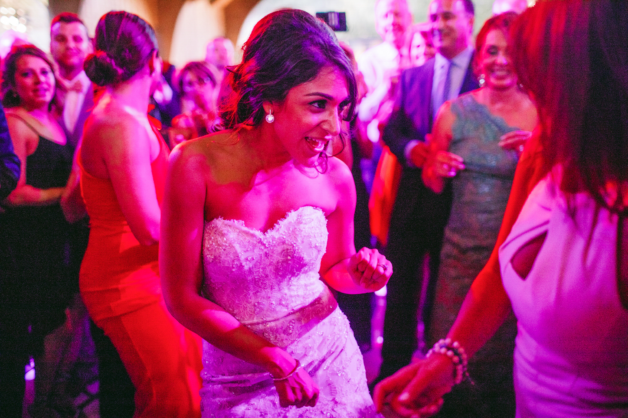 san diego wedding   photographer | bride dancing with woman in white dress in the middle of   dancing crowd