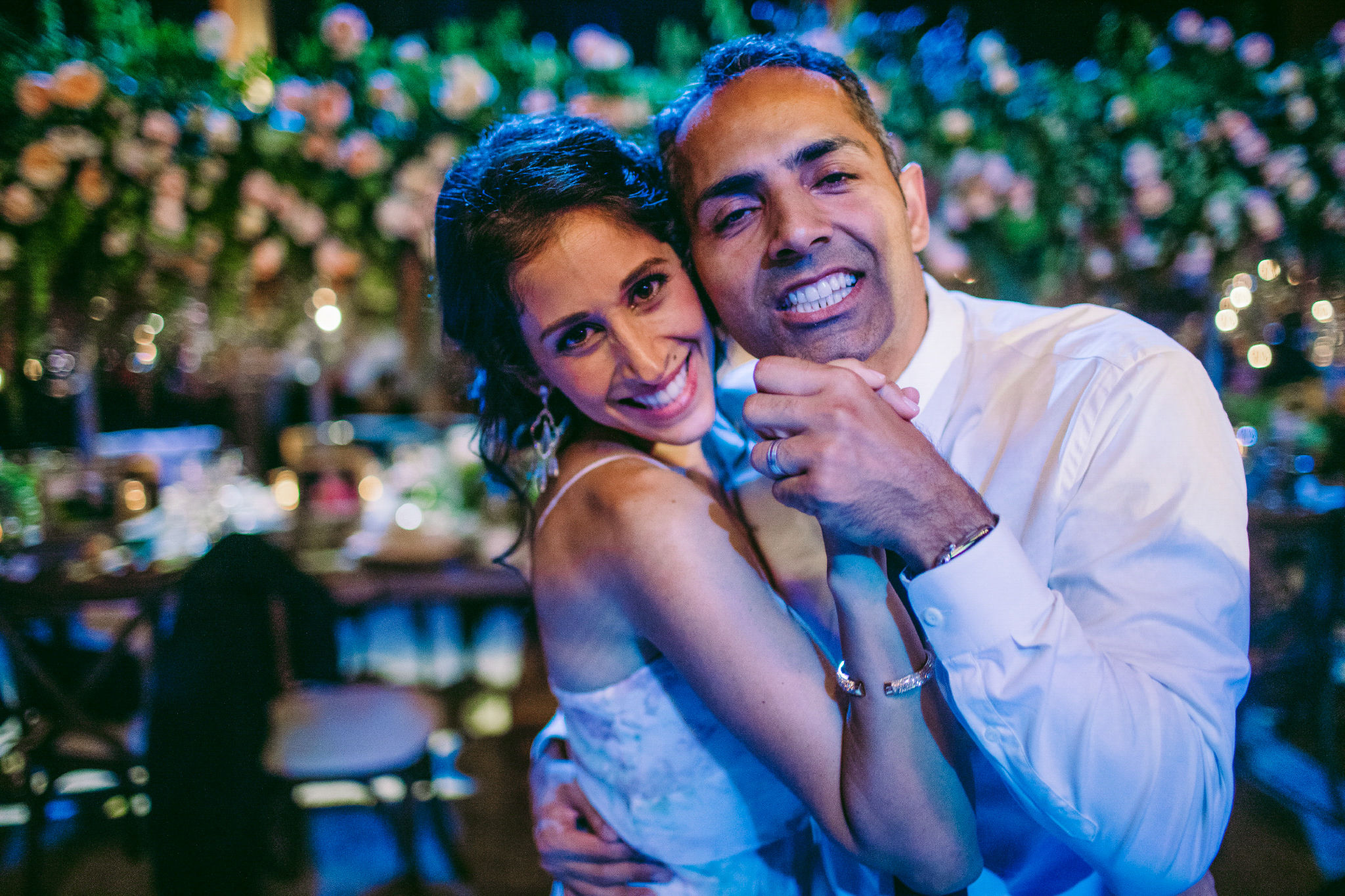 san diego wedding   photographer | bride smiling and dancing with man while looking into the   camera