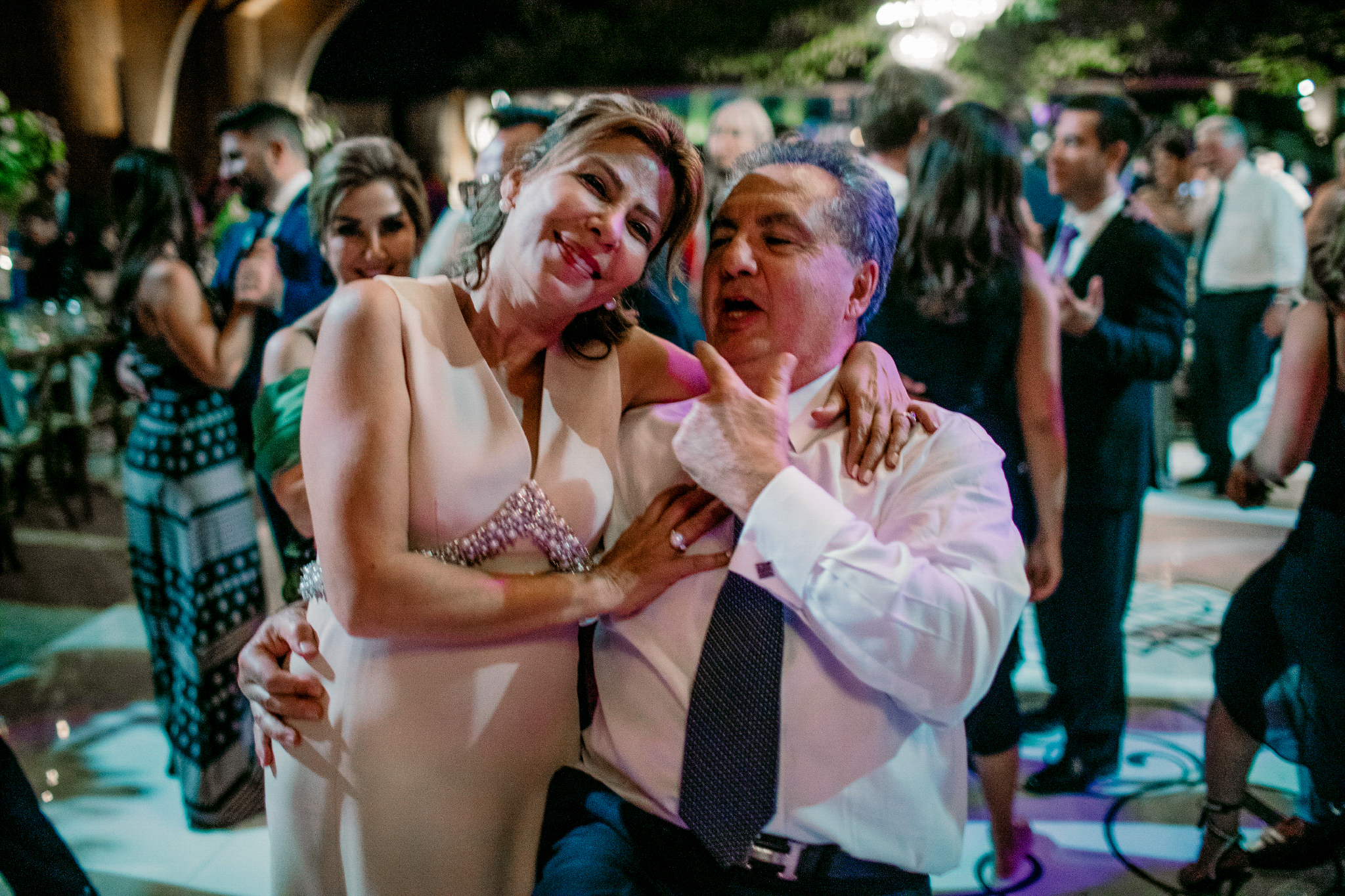 san diego wedding   photographer | middle aged couple dancing together with dancing crowd in   background