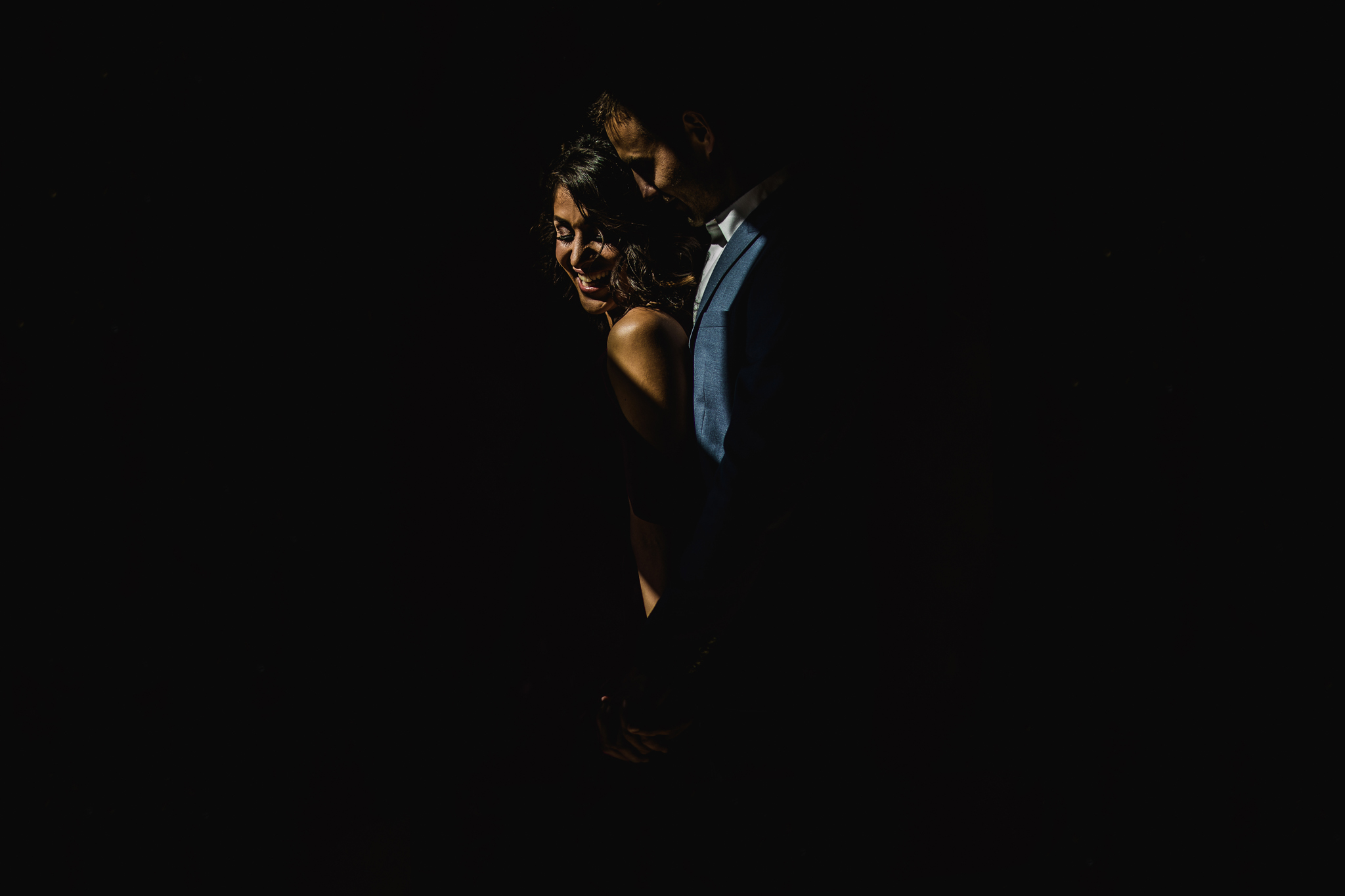 san diego wedding   photographer | low light picture of married couple with groom behind bride