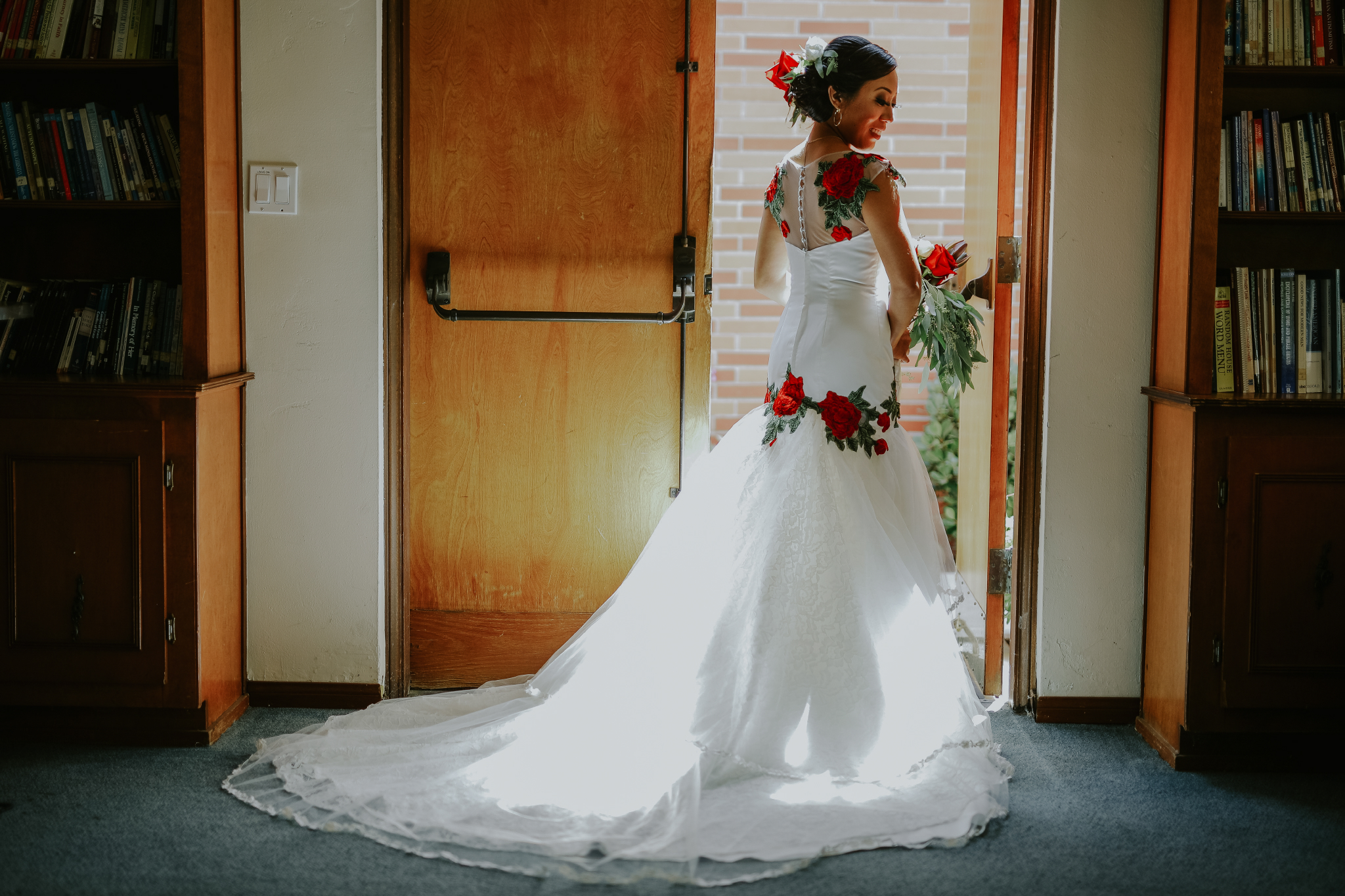 San Diego Wedding Photographer | bride posing next to the door