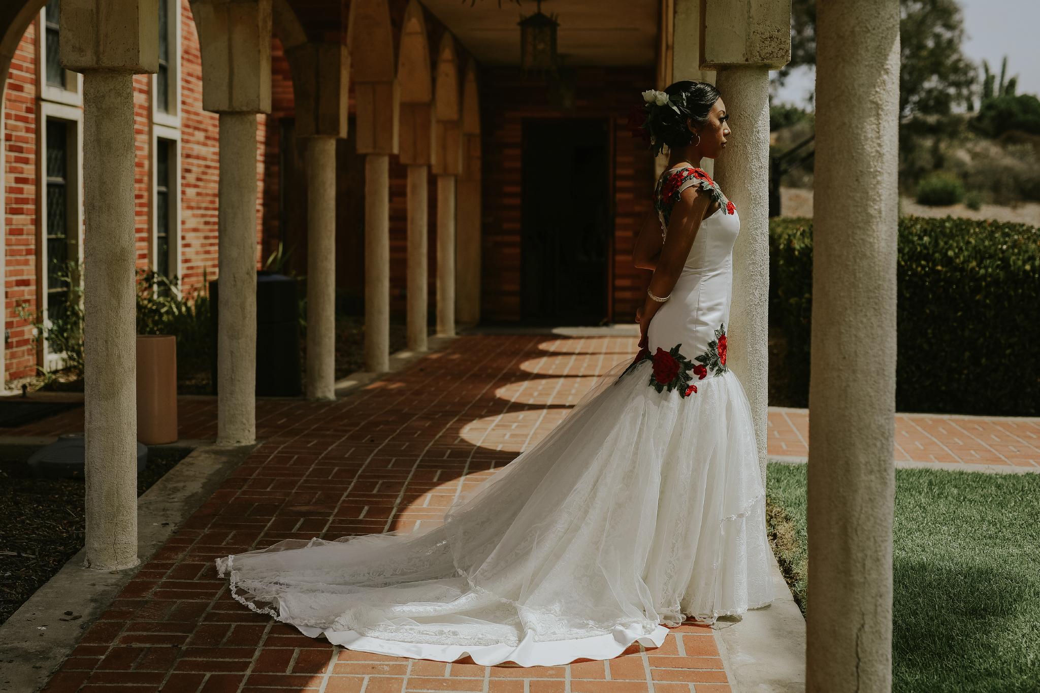San Diego Wedding Photographer | bride posing in Torrey pines church