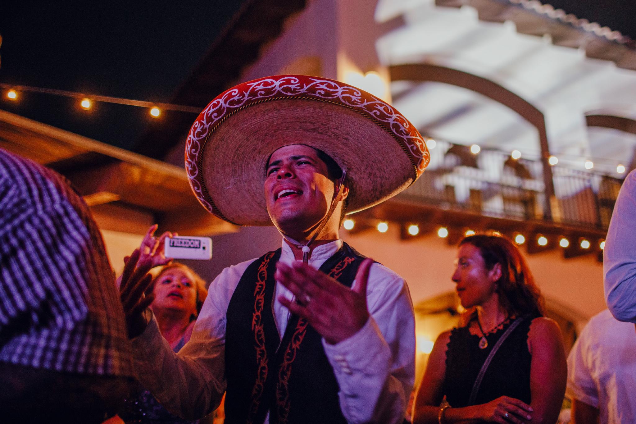San Diego Wedding Photographer | groom enjoying her bride's performance