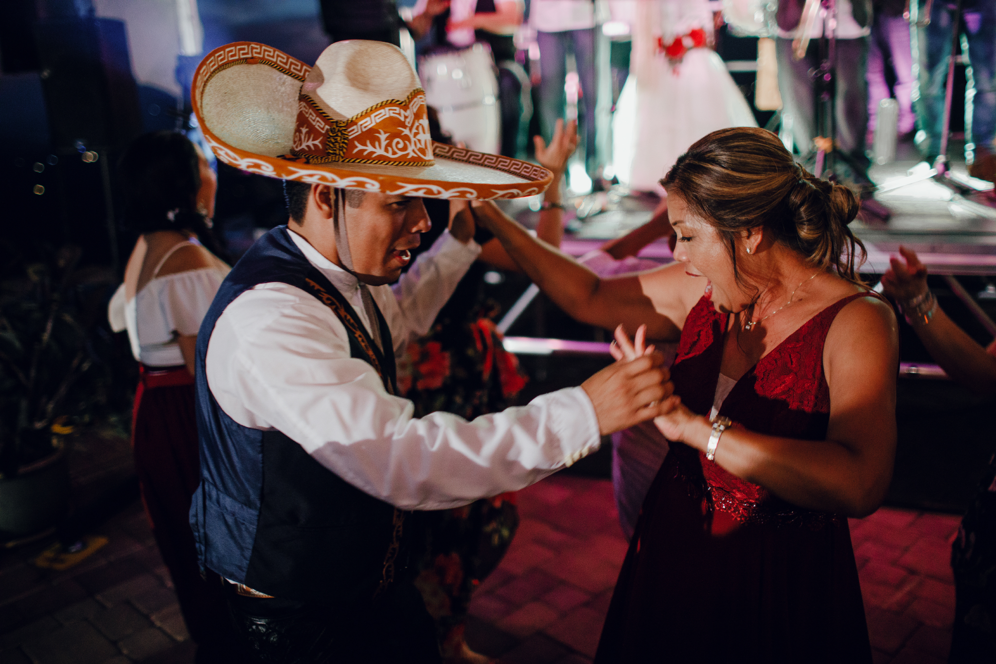 San Diego Wedding Photographer | groom and his step mom enjoying at the reception