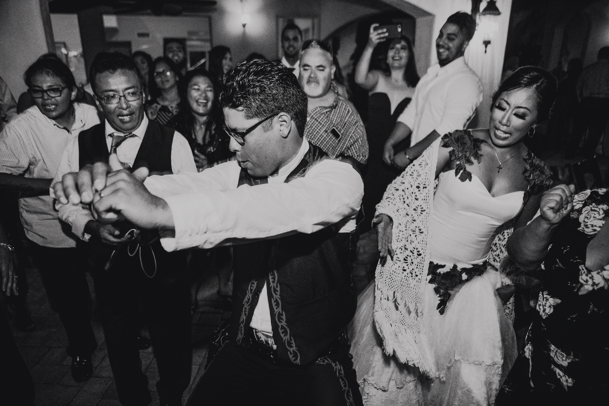 San Diego Wedding Photographer | bride looking at grooms ass while he dances