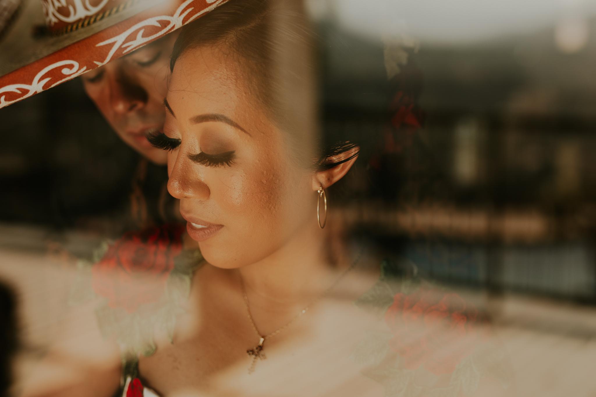San Diego Wedding Photographer | couple portrait next to glass panel