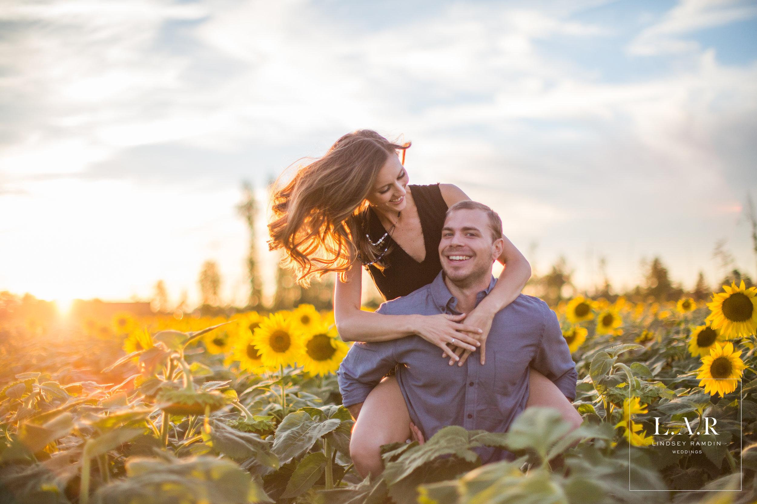 Sunflower Field Engagement Photos | L..A.R. Weddings