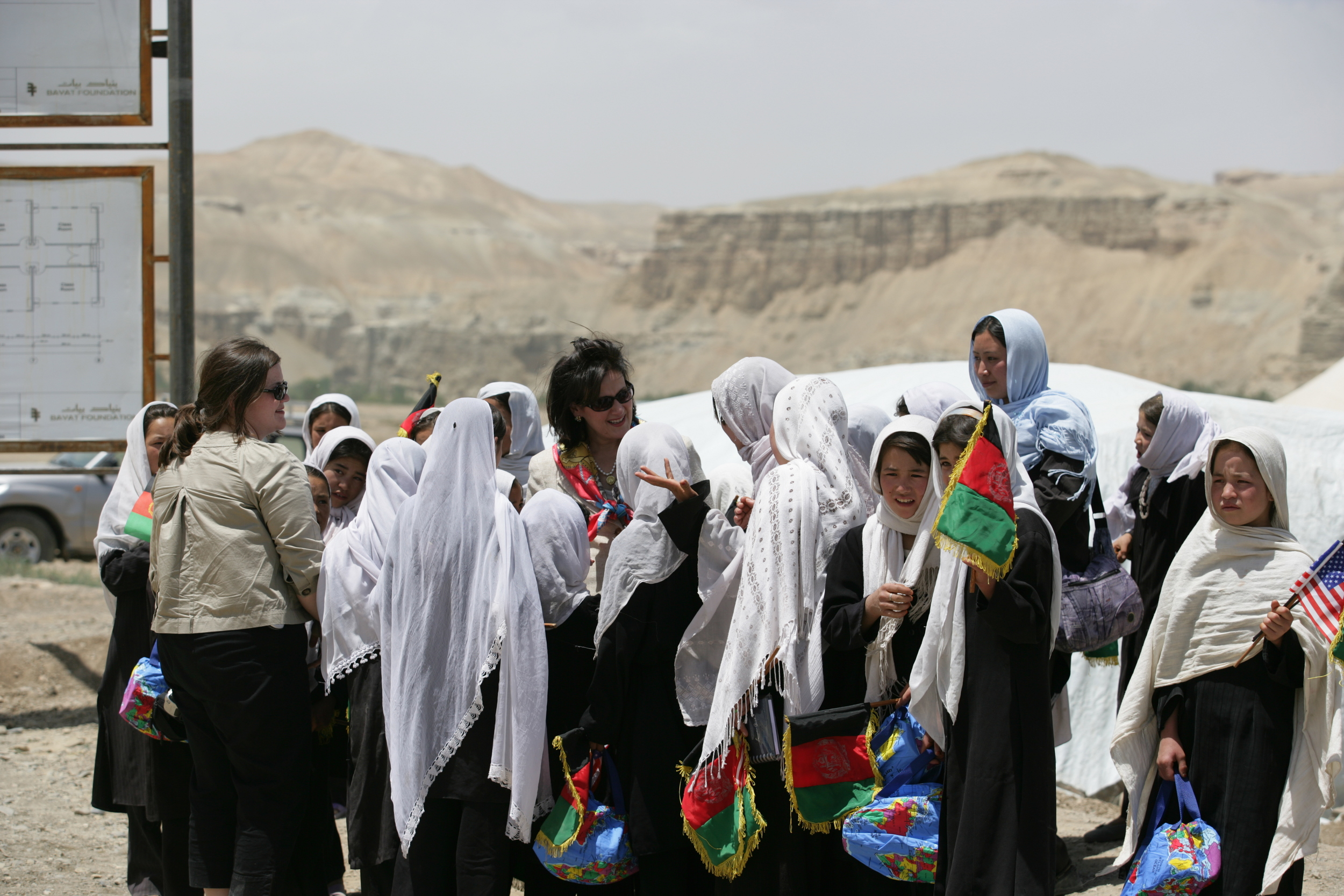 Deanna visiting with young Afghan girls during a tour of the construction site of the Ayenda Learning Center. Bamiyan, Afghanistan - 2008