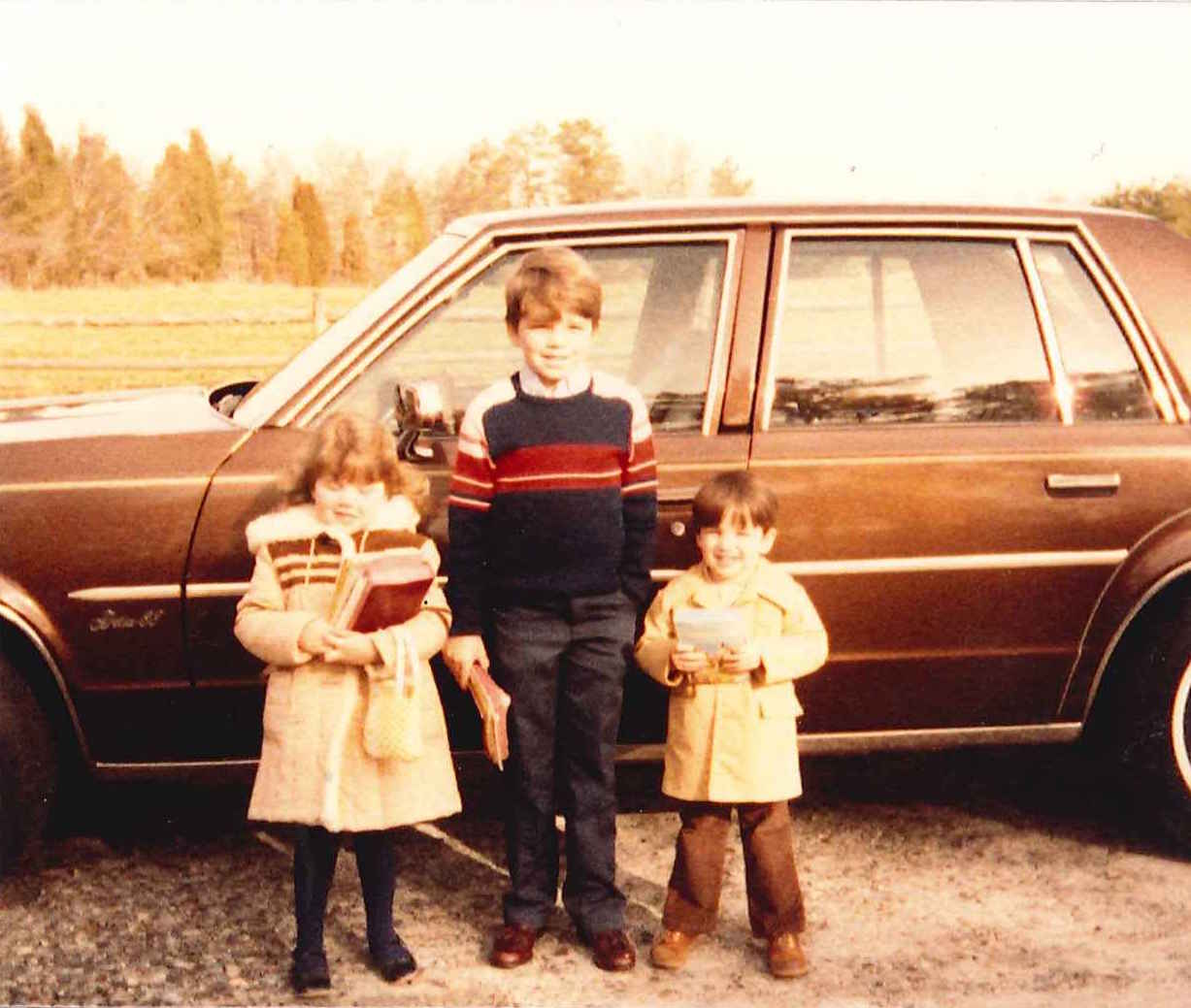 Deanna, older brother Brian, and younger brother Phillip ready to go to Sunday morning church service. Iron Station, North Carolina - 1983