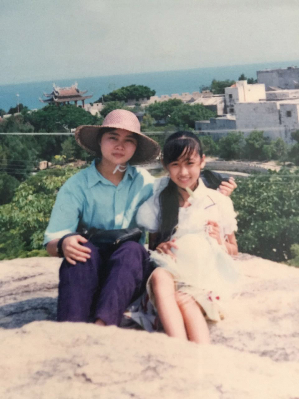 Becky and her aunt sit in a park in Guangdong in the 1980s
