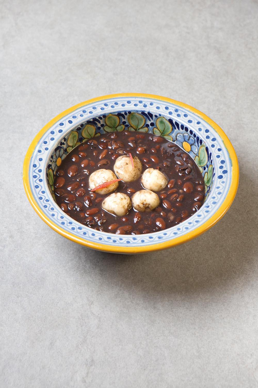 Cassava dumplings with black beans