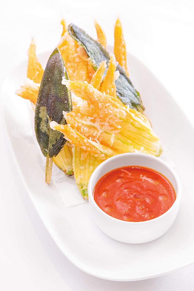Deep-fried zucchini flowers and sage with anchovies