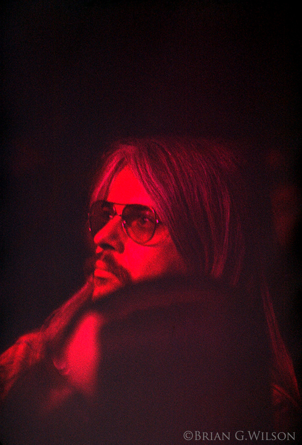 Leon Russell looks on prior to taking the stage for the second half with Billy and George.