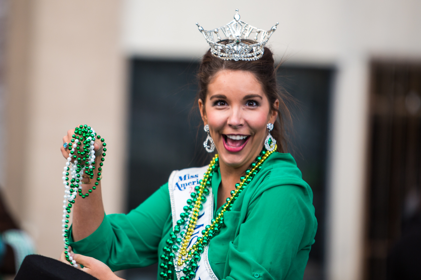 The adorable Miss Arkansas Loren McDaniels throwing me beads. I shot with the right hand, caught with the left!