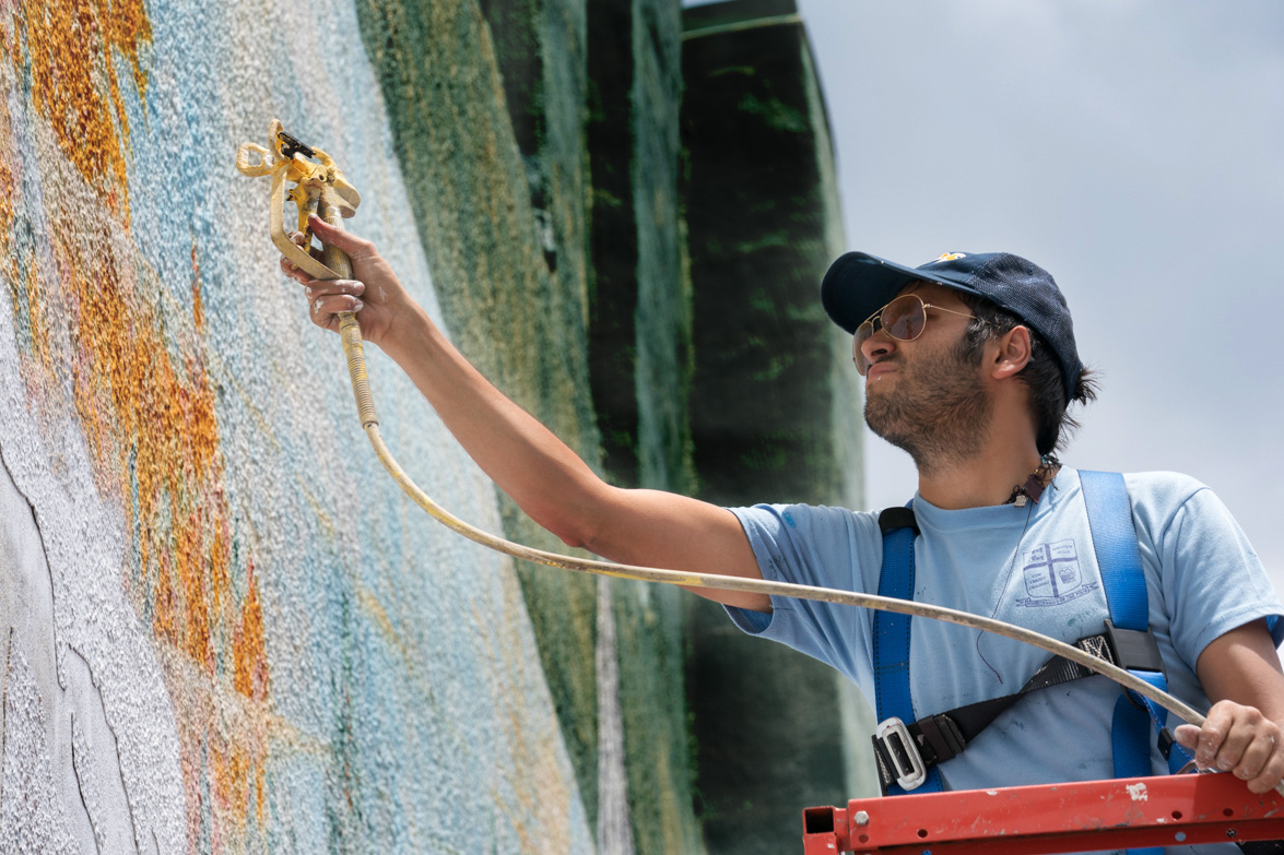 Giuseppe Percivati begins work on the mural in downtown Hot Springs.
